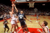 Georgetown's star center Alonzo Mourning battles UConn's Nadav Henefeld for a rebound during a Big East tournament game Hartford CT 1990