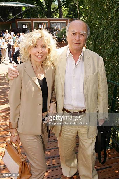 Georgges Wolinski and his wife visit the Roland Garros village during the 2004 French Open Tennis