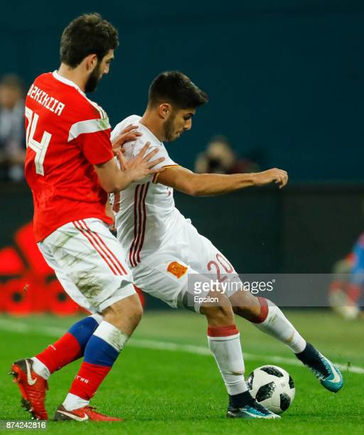 Georgi Dzhikiya of Russia and Marco Asensio of Spain vie for the ball during Russia and Spain International friendly match on November 14 2017 at...