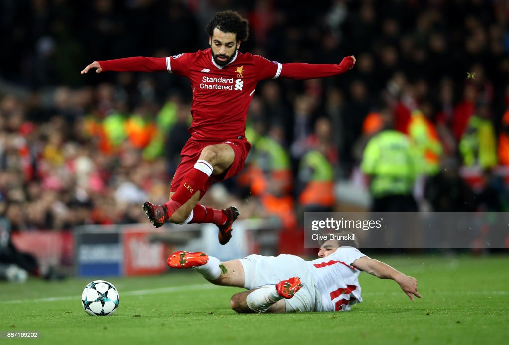 Georgi Dzhikiya of Spartak Moskva tackles Mohamed Salah of Liverpool during the UEFA Champions League group E match between Liverpool FC and Spartak Moskva at Anfield on December 6, 2017 in Liverpool, United Kingdom.