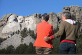 Georgia and Keith Ormand stop to take a picture near the entrance to Mount Rushmore National Memorial on October 1 2013 in Keystone South Dakota The...