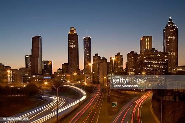 USA, Georgia, Atlanta, traffic on highways leading towards downtown city at dusk, long exposure