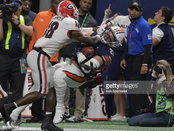 Georgia Bulldogs defensive back Deandre Baker tackles Auburn Tigers fullback Chandler Cox during the SEC Championship game between the Georgia...