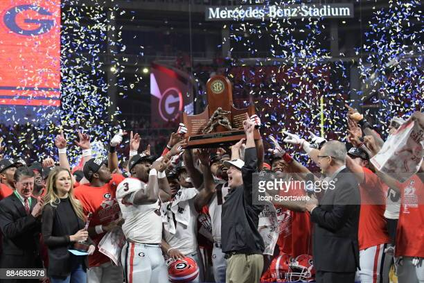 Georgia Bulldogs Head Coach Kirby Smart and the rest of the team celebrate after winning the SEC Championship game between the Georgia Bulldogs and...