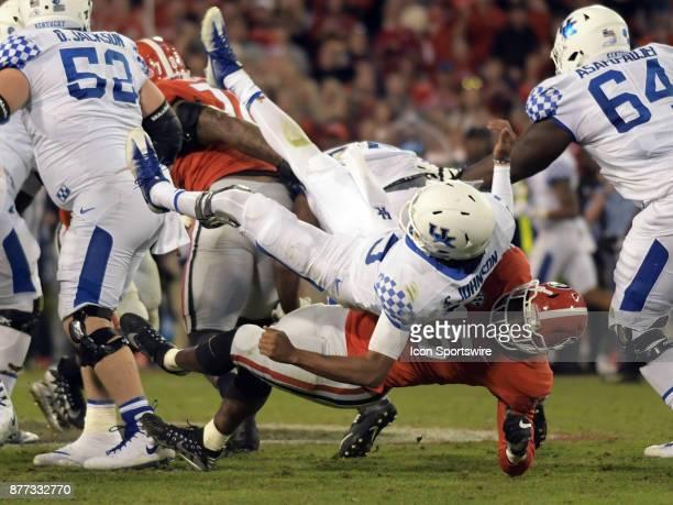 Georgia Bulldogs linebacker D'Andre Walker slams Kentucky Wildcats quarterback Stephen Johnson during the game between the Kentucky Wildcats and the...