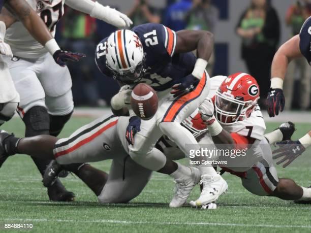 Georgia Bulldogs linebacker Lorenzo Carter strips the ball from Auburn Tigers running back Kerryon Johnson during the SEC Championship game between...