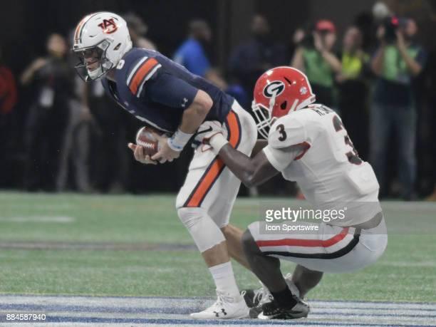 Georgia Bulldogs linebacker Roquan Smith sacks Auburn Tigers quarterback Jarrett Stidham during the SEC Championship game between the Georgia...