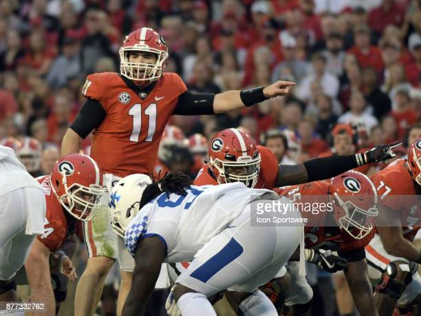 Georgia Bulldogs quarterback Jake Fromm and Georgia Bulldogs offensive linemen Justin Shaffer point out blocking assignments before the snap during...