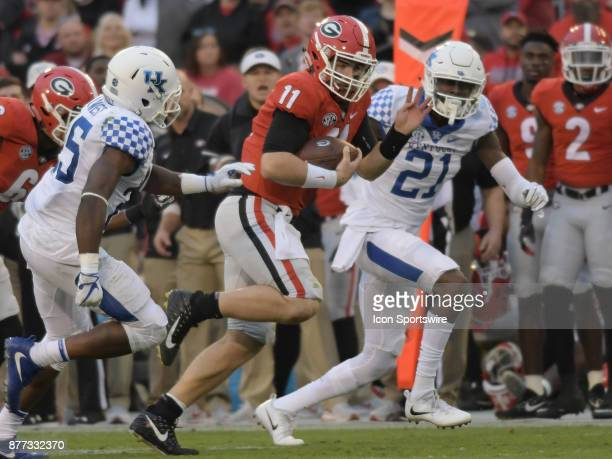 Georgia Bulldogs quarterback Jake Fromm rushes the ball as Kentucky Wildcats defensive back Darius West pursues during the game between the Kentucky...