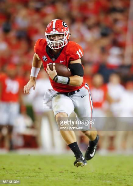 Georgia Bulldogs quarterback Jake Fromm scrambles in the first half of the Missouri Tigers v Georgia Bulldogs game on October 14 2017 at Sanford...