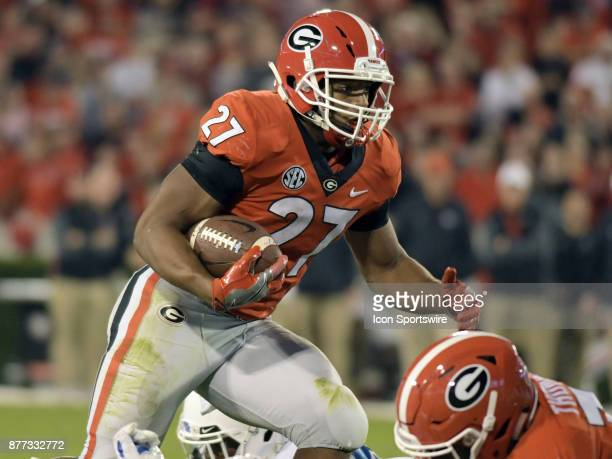 Georgia Bulldogs running back Nick Chubb rushes the ball during the game between the Kentucky Wildcats and the Georgia Bulldogs on November 18 at...