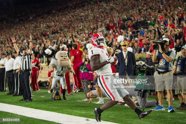 Georgia Bulldogs running back Sony Michel runs for a 6yard touchdown during the college football game between the Notre Dame Fighting Irish and...
