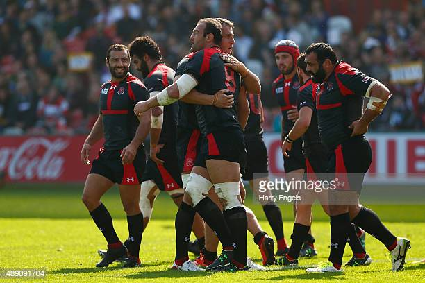 Georgia captain Mamuka Gorgodze is congratulated by teammates after scoring his team's first try during the 2015 Rugby World Cup Pool C match between...