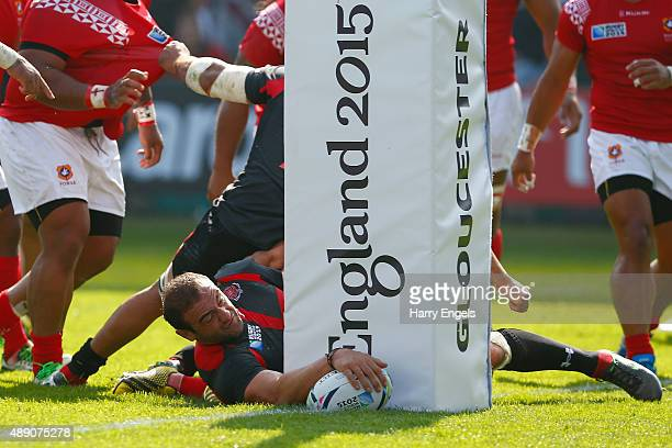 Georgia captain Mamuka Gorgodze scores his team's first try during the 2015 Rugby World Cup Pool C match between Tonga and Georgia at Kingsholm...