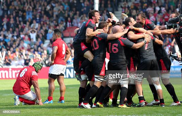 Georgia celebrate their victory over Tonga during the Group C Rugby World Cup match between Tonga and Georgia at Kingsholm Stadium Stadium on...