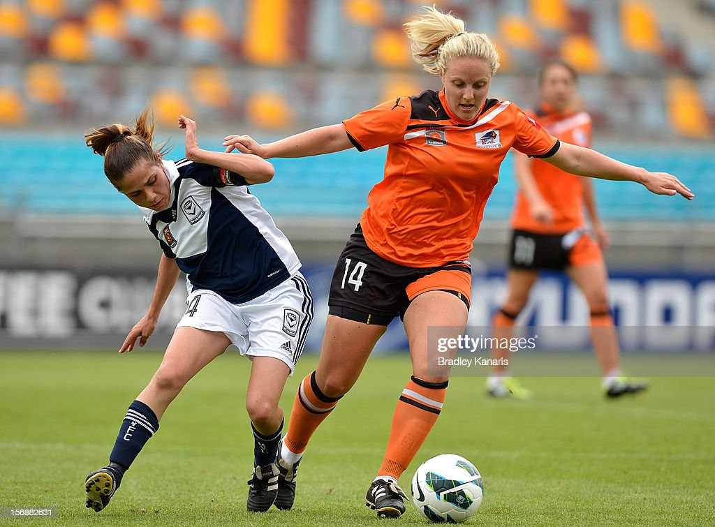 Georgia Chapman of the Roar and Enza Barilla of the Victory compete for the ball during the round six W-League match between the Brisbane Roar and the Melbourne Victory at the Queensland Sport and Athletics Centre on November 24, 2012 in Brisbane, Australia.