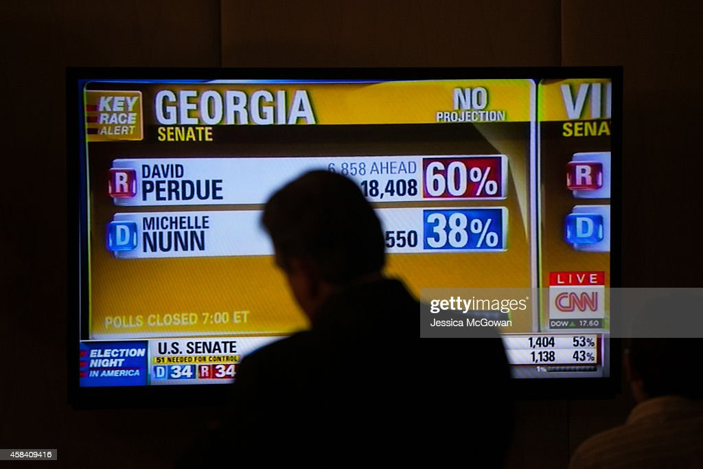 Georgia Democratic US Senate candidate Michelle Nunn supporters watch early election results during a party at the Hyatt Regency in downtown Atlanta...