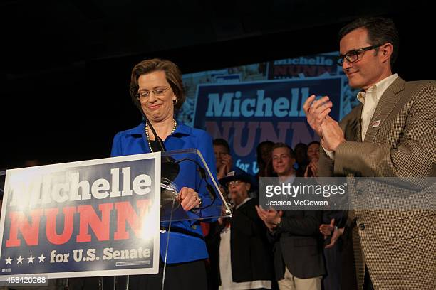Georgia Democratic US Senate candidate Michelle Nunn with husband Ron Martin makes a concession speech to supporters gathered at the Hyatt Regency in...