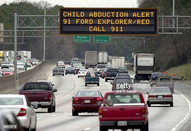 Georgia Department of Transportation sign alerts drivers to look for the vehicle of quadruple murder and kidnapping suspect Jerry William Jones...