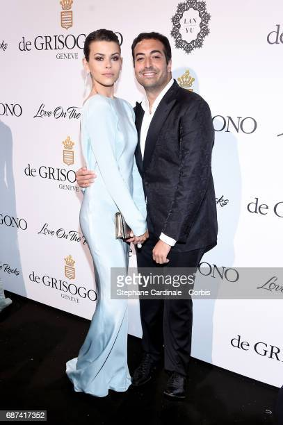 Georgia Fowler and Mohammed Al Turki attend DeGrisogono 'Love On The Rocks' during the 70th annual Cannes Film Festival at Hotel du CapEdenRoc on May...