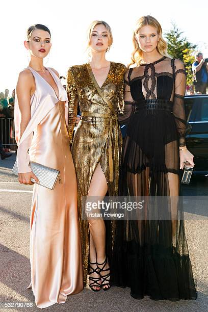 Georgia Fowler Megan Williams and Nadine Leopold arrive at the amfAR's 23rd Cinema Against AIDS Gala at Hotel du CapEdenRoc on May 19 2016 in Cap...