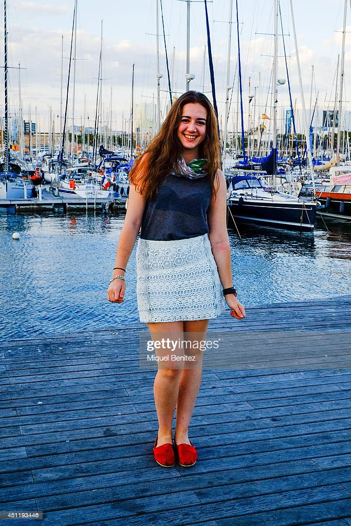 Georgia from Canada seen wearing a All Saints's top, a Maje skirt, Toms shoes and Folli Follie watch on June 25, 2014 in Barcelona, Spain.