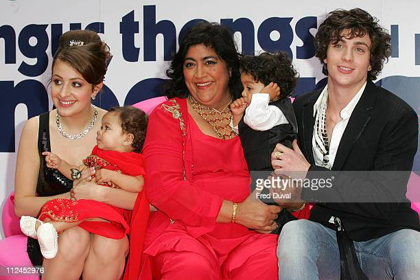 Georgia Groome Director Gurinder Chadha and children sit with Aaron Johnson at the UK premiere of Angus Thongs and Perfect Snogging at The Empire...