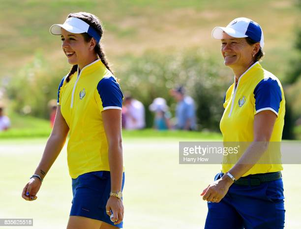 Georgia Hall and Catriona Matthew of Team Europe smile as they leave the 12th green after a birdie putt from Hall during the evening fourball matches...