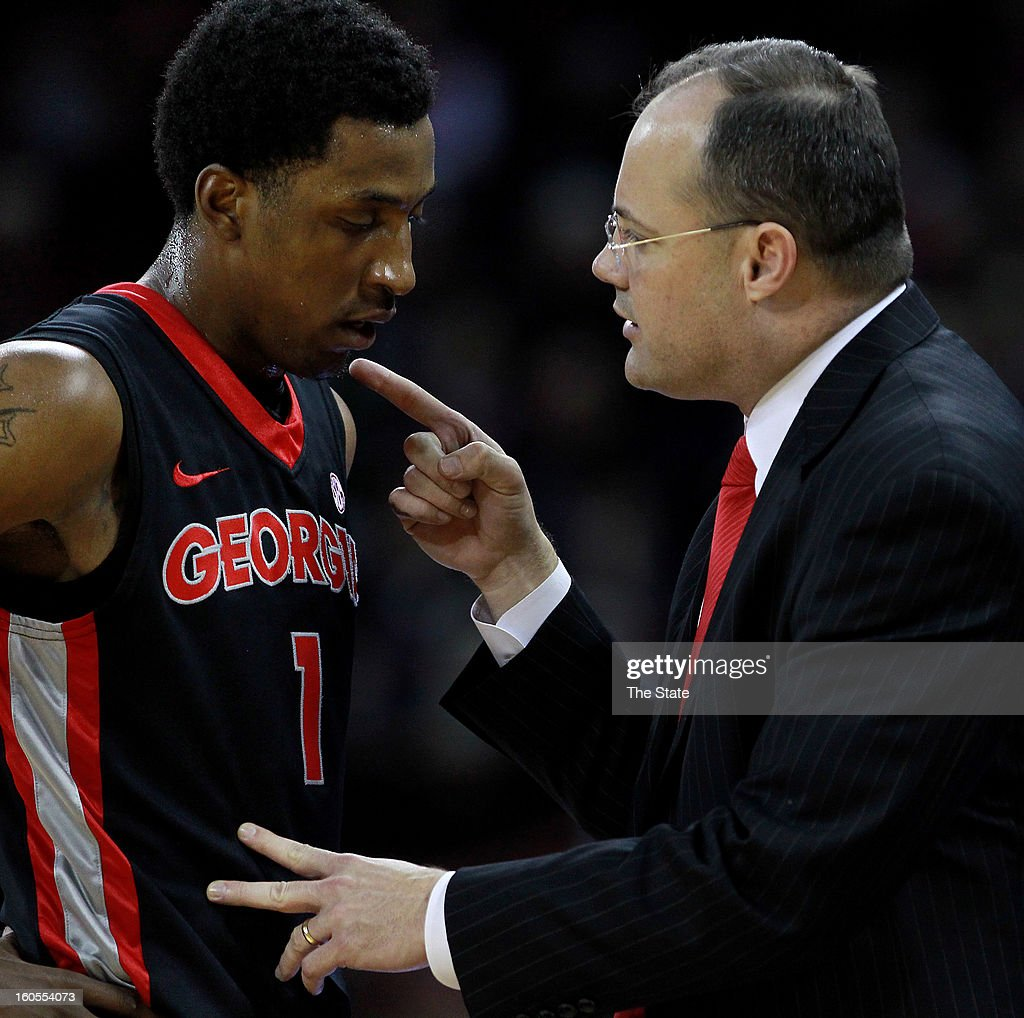 Georgia head basketball coach Mark Fox gives instruction to Kentavious Caldwell-Pope in the first period against South Carolina at the Colonial Life Arena in Columbia, South Carolina, on Saturday, February 2, 2013. Georgia won, 67-56.