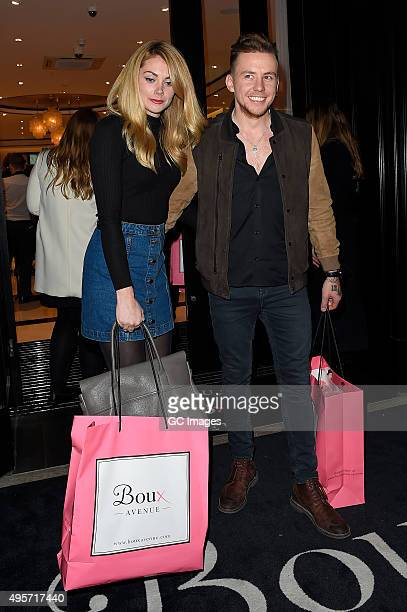 Georgia Horsley and Danny Jones leave Boux Avenue Store opening on Oxford Street on November 4 2015 in London England