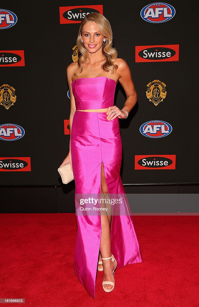 Georgia Mackie the wife of Andrew Mackie of the Cats poses ahead of the 2013 Brownlow Medal at Crown Palladium on September 23, 2013 in Melbourne, Australia.