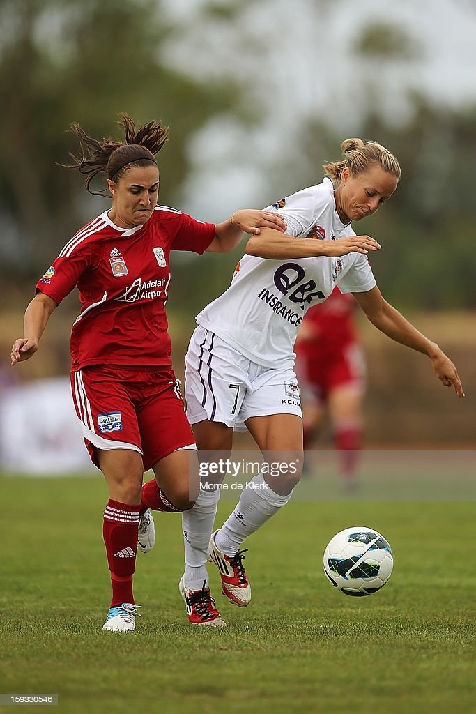Georgia Macri of Adelaide competes with Aivi Luik of Perth during the round 12 W-League match between Adelaide United and the Perth Glory at Burton Park on January 12, 2013 in Adelaide, Australia.