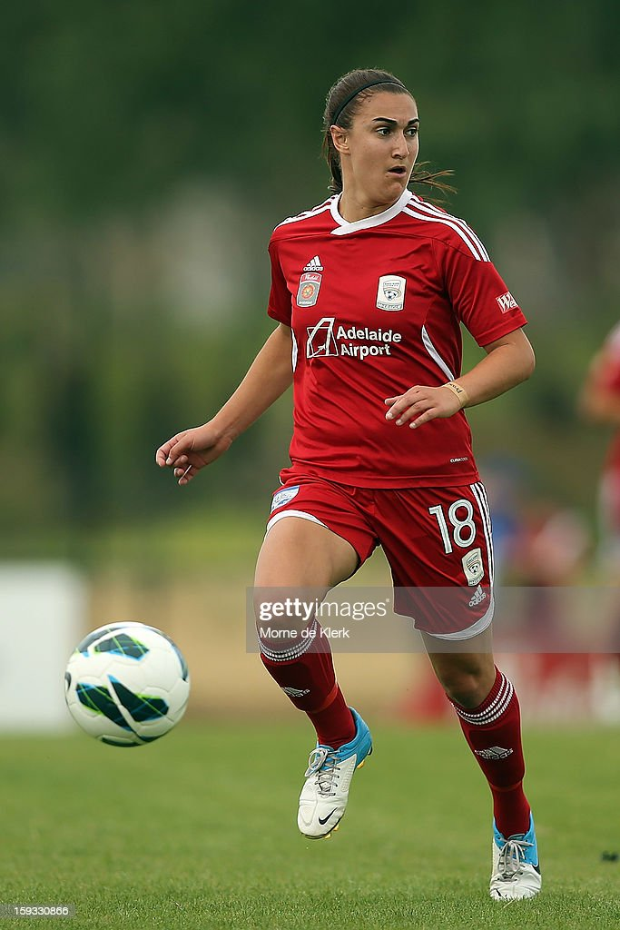 Georgia Macri of Adelaide runs with the ball during the round 12 W-League match between Adelaide United and the Perth Glory at Burton Park on January 12, 2013 in Adelaide, Australia.