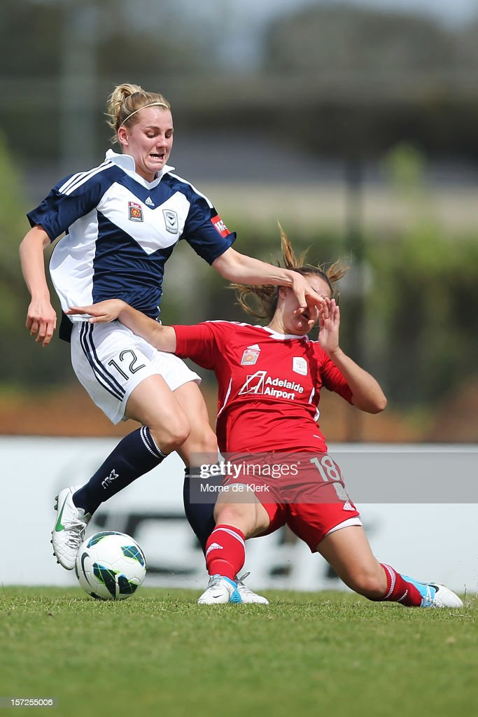 Georgia Macri (R) of Adelaide tackles Jacqueline Vogt (L) of Melbourne during the round seven W-League match between Adelaide United and the Melbourne Victory at Burton Park on December 1, 2012 in Adelaide, Australia.