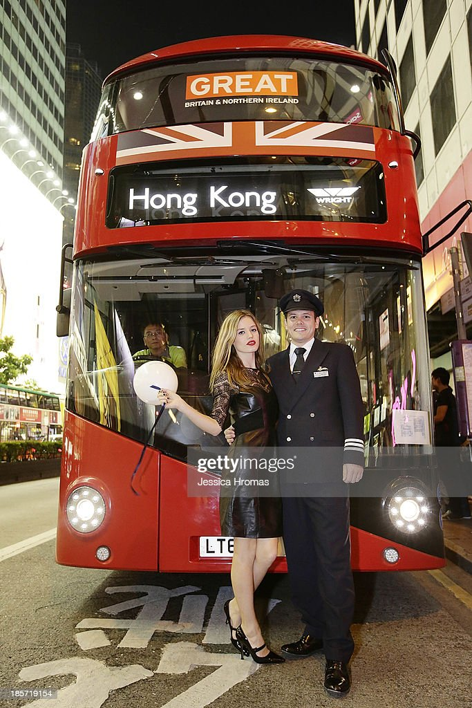 Georgia May Jagger and Senior First Officer Peter Nye hop on board the 'Great Red Bus' to celebrate British Airways A380 launch to Hong Kong on October 24, 2013.