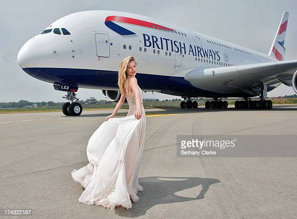 Georgia May Jagger poses next to the new British Airways A380 double decker aircraft at Manston Airport on July 21 2013 in Manston England...