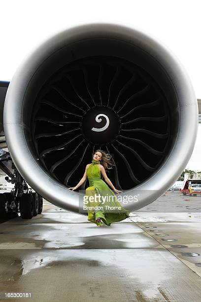 Georgia May Jagger wearing Tech Empire dress by PPQ poses inside an engine of a British Airways 777 airliner on April 3 2013 in Sydney Australia...