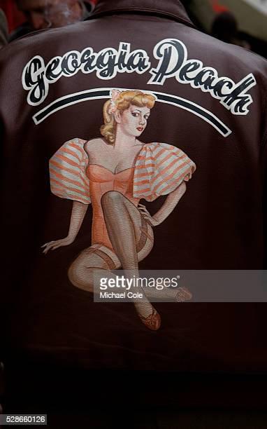 Georgia Peach pinup girl illustration on back of leather bomber jacket