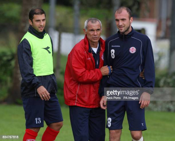 Georgia player Zurab Khizanishvili listens to new head coach Hector Cuper during training at Briton Ferry AFC ground in Neath