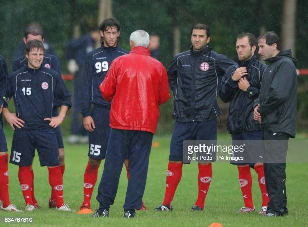 Georgia players listen to new head coach Hector Cuper during training at Briton Ferry AFC ground in Neath