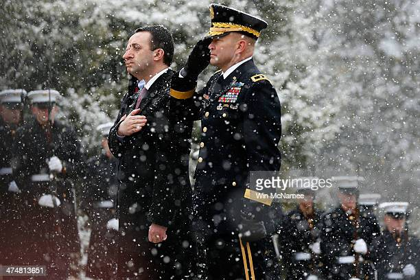 Georgia Prime Minister Irakli Garibashvili escorted by US Army Maj Gen Jeffrey Buchanan commanding general of the Army Military District of...
