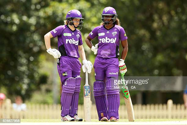 Georgia Redmayne and Hayley Matthews of the Hurricanes talk between overs during the Women's Big Bash League match between the Hobart Hurricanes and...