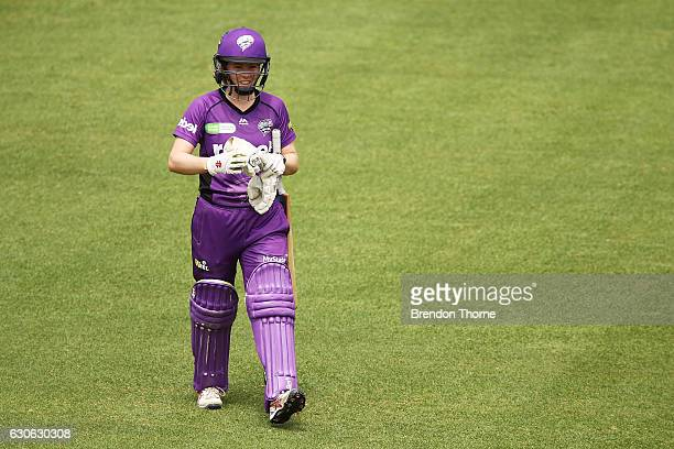 Georgia Redmayne of the Hurricanes walks back to the pavilion after being dismissed by Sarah Aley of the Sixers during the WBBL match between the...