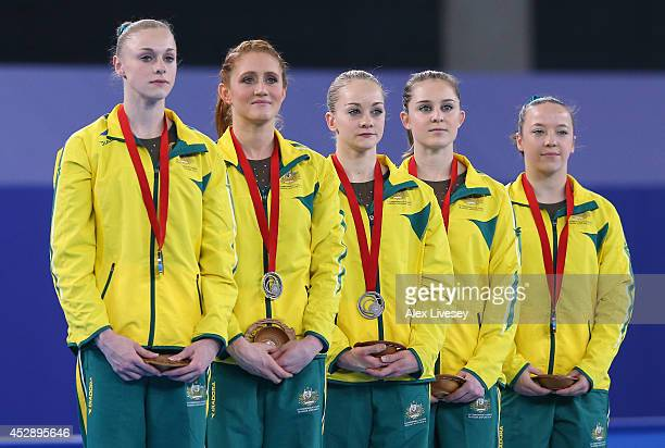 Georgia Rose Brown Larrissa Miller Lauren Mitchell Olivia Vivian and Mary Anne Monckton of Australia receive their silver medals during the medal...