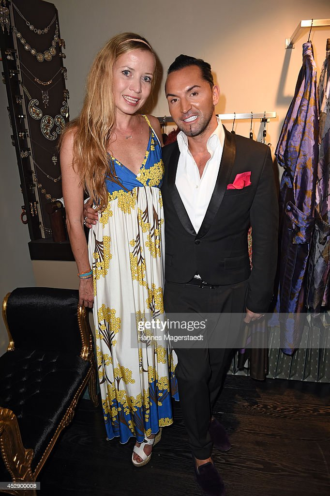 Georgia Schultze and Marcus Heinzelmann attend the Marcus Heinzelmann Boutique Opening on July 29, 2014 in Munich, Germany.
