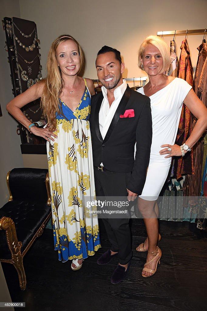 Georgia Schultze, Marcus Heinzelmann and Anke Dietz attend the Marcus Heinzelmann Boutique Opening on July 29, 2014 in Munich, Germany.