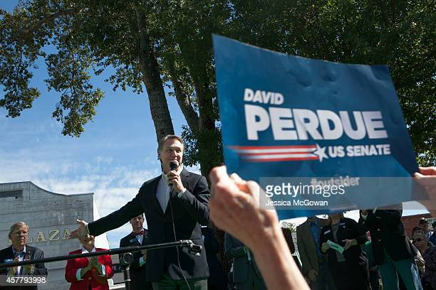Georgia Senate candidate David Perdue addresses the audience gathered at the McDonough Square as he makes a campaign stop with Sen Rand Paul and...