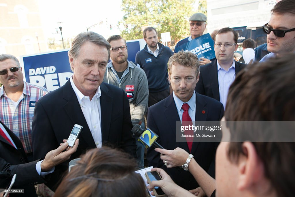 Georgia Senate candidate <a gi-track='captionPersonalityLinkClicked' href=/galleries/search?phrase=David+Perdue&family=editorial&specificpeople=4276858 ng-click='$event.stopPropagation()'>David Perdue</a> (left) with Sen. <a gi-track='captionPersonalityLinkClicked' href=/galleries/search?phrase=Rand+Paul&family=editorial&specificpeople=6939188 ng-click='$event.stopPropagation()'>Rand Paul</a> (R-KY) answer questions from the press during a campaign stop at the McDonough Square on October 24, 2014 in McDonough, Georgia. Perdue is running in a tight race against Democrat Michelle Nunn.
