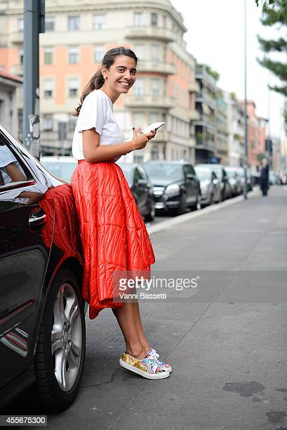 Georgia Tal poses wearing am American Apparel shirt Dior skirt and Superga shoes on September 18 2014 in Milan Italy