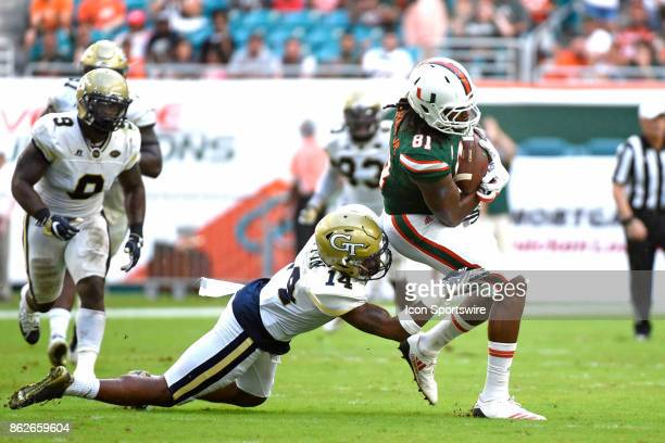Georgia Tech defensive back Corey Griffin tackles University of Miami wide receiver Darrell Langham during an NCAA football game between the Georgia...